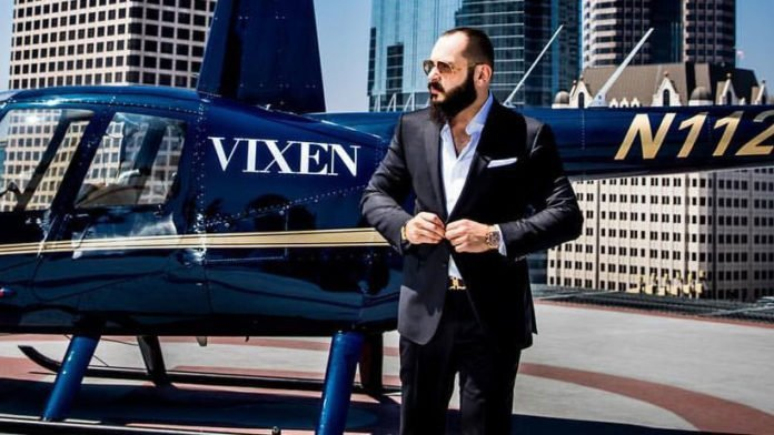 Greg Lansky from Vixen in fron of a helicopter
